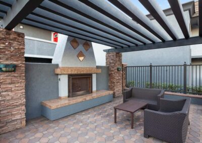 Outdoor fireplace on a bricks style floor