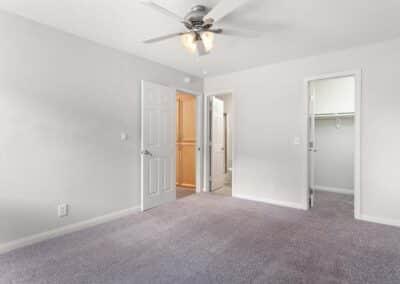 Door open to carpeted bedroom space